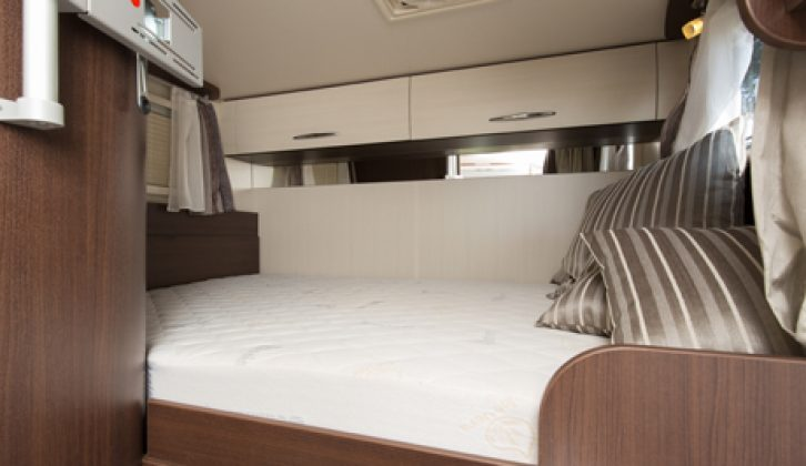There's a fixed double bed in the Benimar Mileo 201