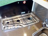 In the Adria Coral Plus 690 SC's kitchen, you'll find a combination oven and grill, and three gas rings on the hob