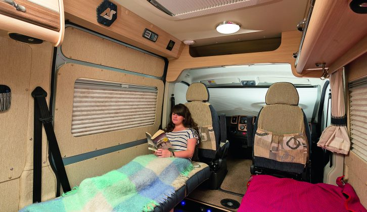 It's quick and easy to turn the seat by the side door into a single bed, but then your only exits are through the cab doors or a high jump down from the van's rear doors