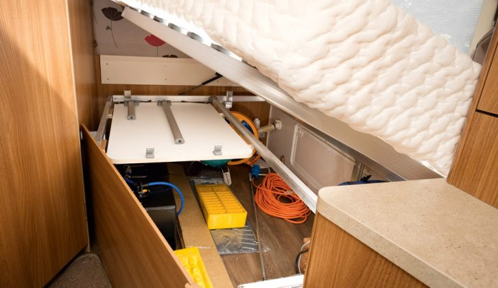 Storage space, with external access, is available under the fixed bed and this is where the folding table is stored, plus the water tank
