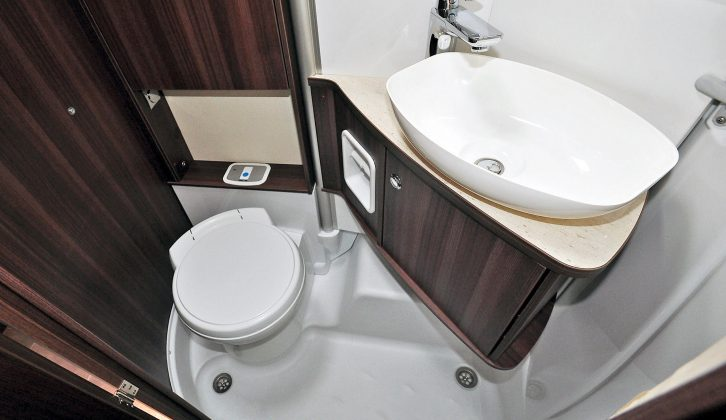 The sink bulkhead is hinged to swing away and form a full-size shower cubicle, allowing optimal storage