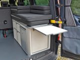 A hinged worktop extension flap encourages al fresco dining; sturdy pouches in the rear doors of the Leisure Van accommodate folding camping chairs