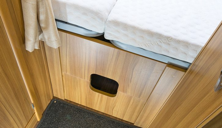 Below the rear bed is a wooden aperture that divides the bedroom from the rest of the habitation area – and there's a slot in it so that you can store long thin things such as skis