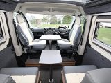 The cab seats are higher than the rear ones, but this isn't a problem as two island legs and different-sized table tops are included
