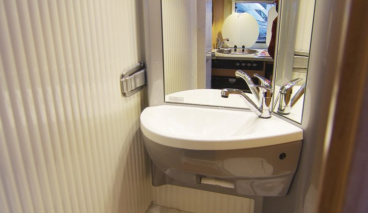 In the T60's washroom, wet shavers will appreciate the large sink and generous, well-lit mirror. The grey catch on the left releases the rear washroom wall