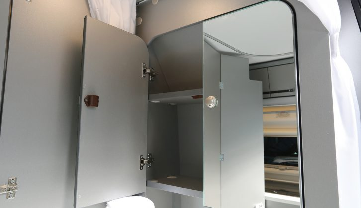 There's even a mirrored wall cupboard with plenty of space for washbags in the Adria Twin 500 S campervan washroom