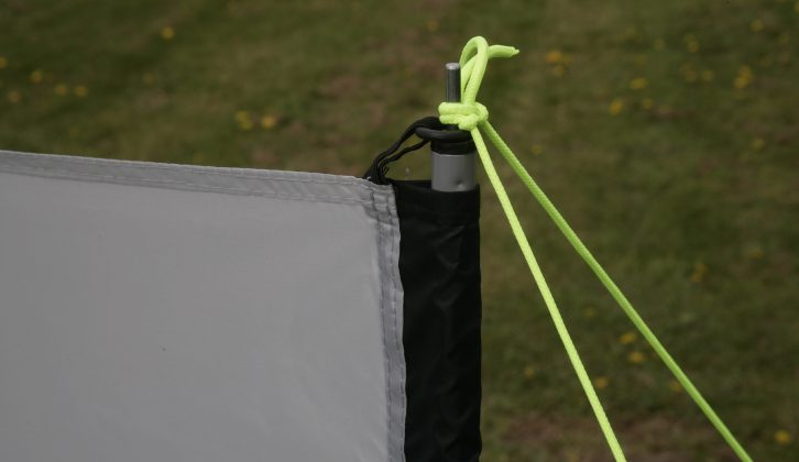 The windbreak fabric is hung from each pole spike, which the guy lines simply tie onto as well
