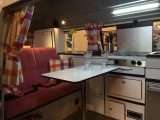 A classic body but a modern interior for this pink VW campervan – see it at the NEC