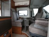 The cab seats swivel and turn the front dinette into a lounge for four