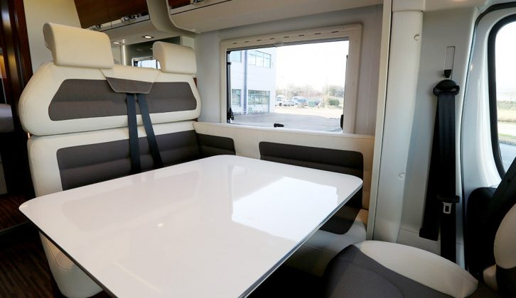 You can seat six people around the dining table in the 670 SC, the seats upholstered here in the 'White Santos' cream and chocolate scheme