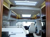 Thanks to a good-sized over-lounge rooflight and a cab rooflight, as well as light coming in from the side windows and the cab, this motorhome's living space is well-lit