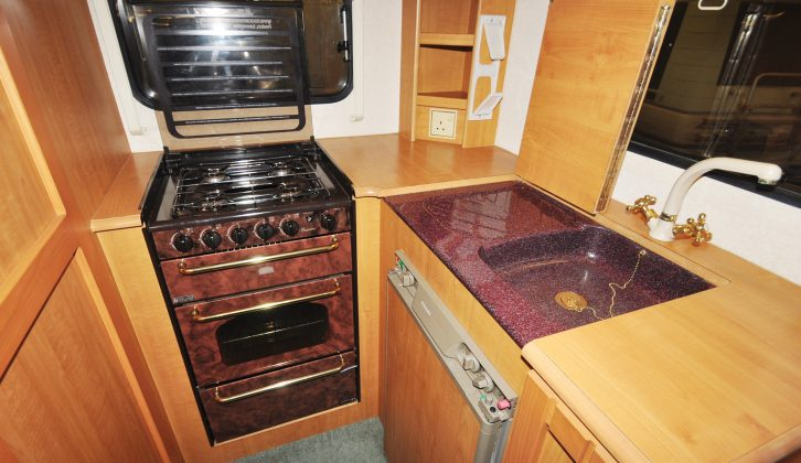 The Auto-Trail Tracker has an amazing kitchen for such a small vehicle, with a cooker, sink, drainer, worktop and more