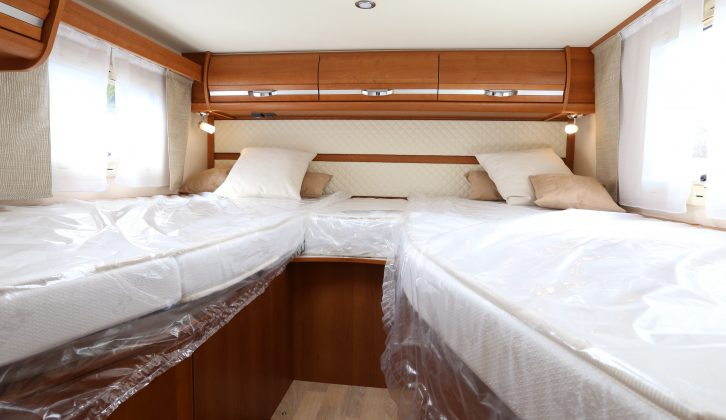 At the rear are two fixed single beds, which are accessed by three steps between them, with padded headboards and Bultex density foam mattresses – each measures 2m x 0.85m