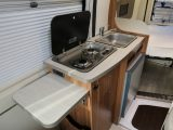 You get just two gas burners, a sink and a compressor fridge in the Pilote Foxy Van V540G, plus a useful worktop extension flap – you can glimpse the bed beyond