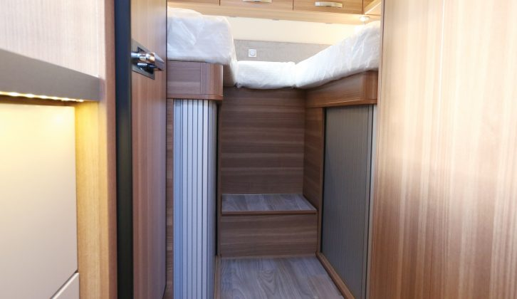 There are two steps up to the twin single beds at the rear, and space-saving tambour doors on the wardrobes