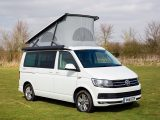 Our test VW campervan looks resplendent in its Oryx White pearlescent paint (£606) – the awning is a £396 option