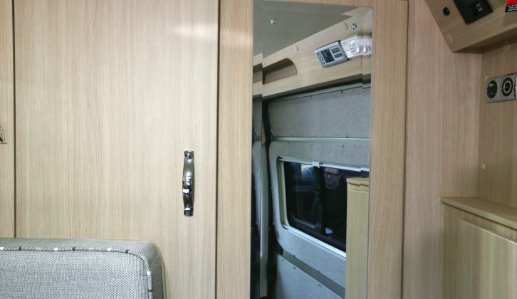 The door of this cupboard, and that of the wardrobe, can be brought together to make a separate dressing space at the back of the 'van
