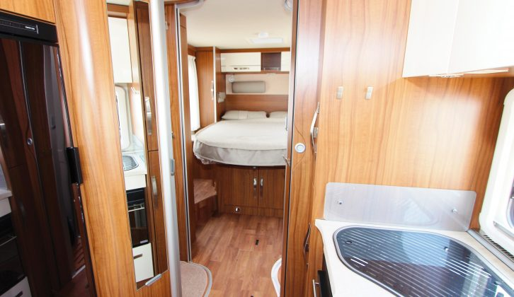 The view rearwards from the kitchen shows the washroom on the left, the shower on the right, and the rear island bed beyond