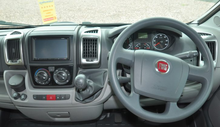 This used motorhome's roomy cab boasts a double-DIN stereo with sat-nav, among other features, as well as plushly made leather seats