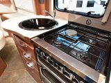 There's a dual-fuel hob with three gas burners and one electric, a Thetford oven with a separate grill and a black enamel sink, but worktop space is limited