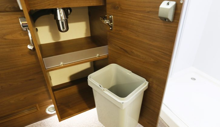 There's a handy bin mounted on the rear of the vanity unit's door