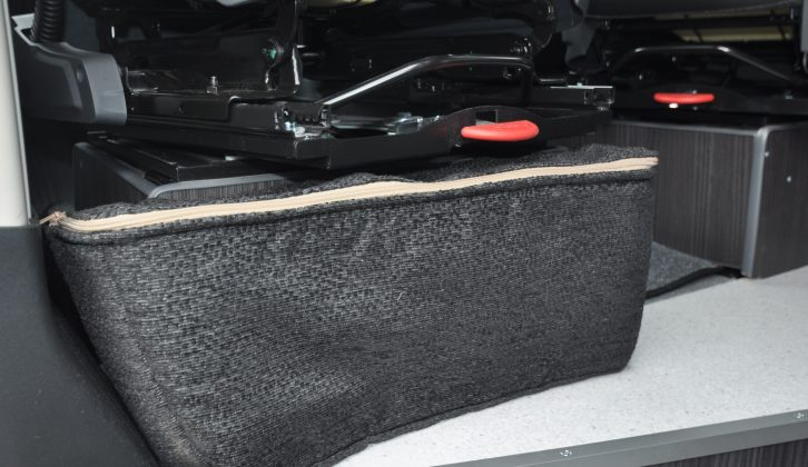 This neat zipped soft bag at the base of the cab passenger's seat will come in handy