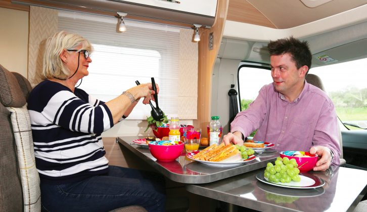 The clip-on table in the front dinette includes a swing-out extension that will also bring the occupant of the driver's seat into play at mealtimes