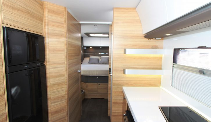 The kitchen is behind the lounge and while some motorhomes offer form or function, this 'van delivers both, in abundance