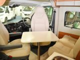You step up into the front lounge of this Tribute motorhome, which is a bit of a squeeze – the table works best if at a jaunty angle