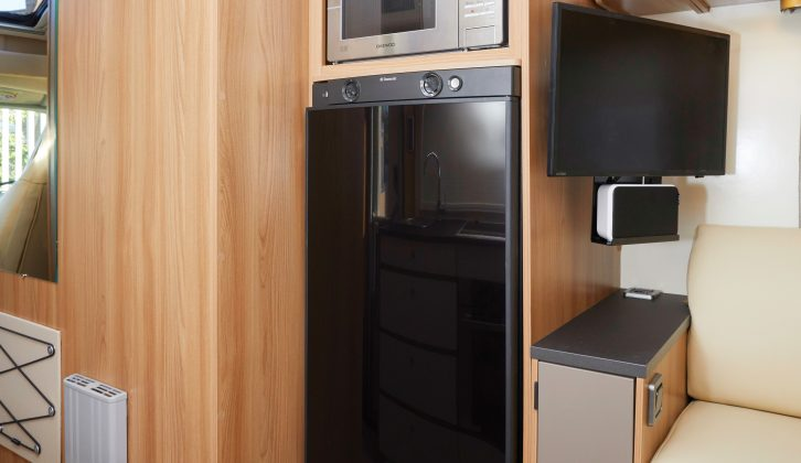 You'll find the tall fridge/freezer unit and microwave oven on the offside –  the flatscreen TV is part of both Media Packs