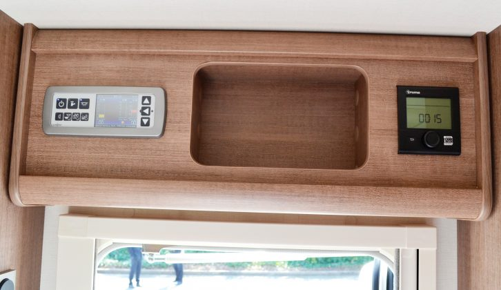 The control panels are located above the entrance door, as is a cubby hole that's ideal for placing keys, torches and other bits of kit
