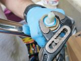 The top section of the tap lifts off to reveal a brass locking nut, which can be removed using an adjustable wrench