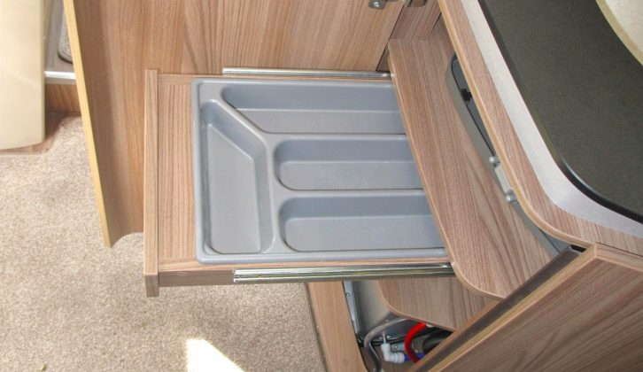 Space under the worktop opens out with a cutlery tray and three shelves, although the Alde heater takes up the lower part