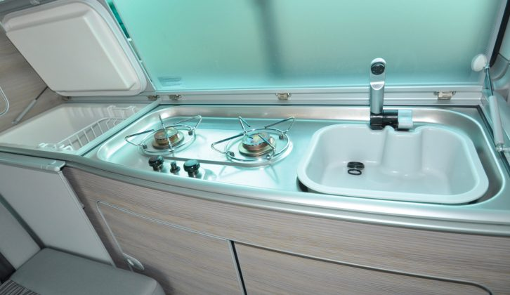 In this 2013 VW camper van the kitchen is in fine fettle apart from the (expected) heat marks to the hob