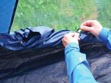 This motorhome awning has an inbuilt groundsheet, while the windows have toggle curtains