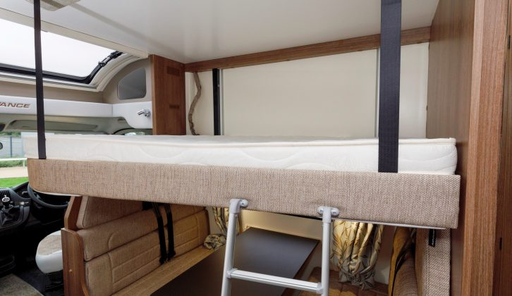 Access to the drop-down double is via this ladder and it's very comfy once you're there – the dinette below makes up into further berths