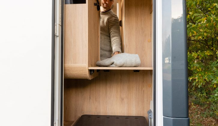 Clever design includes a tall door providing access to the capacious wardrobe from both inside and outside the motorhome