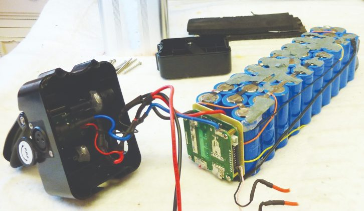 Internal components of electric bike battery, showing cells and BMS