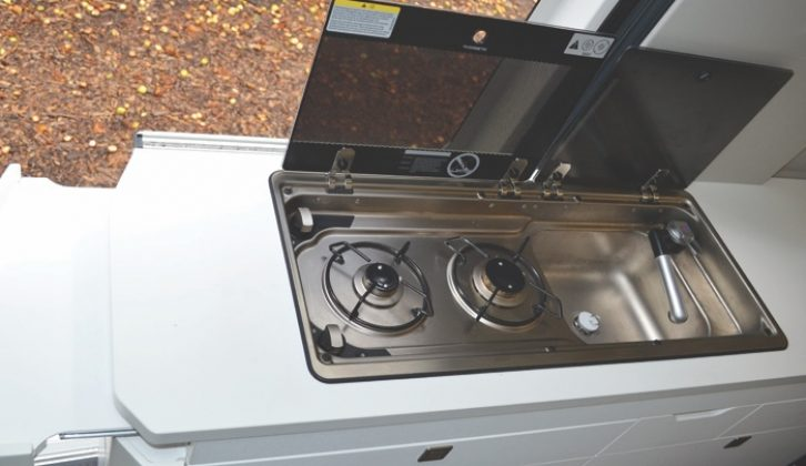 Area around the two-burner hob and sink is well lit with a striplight
