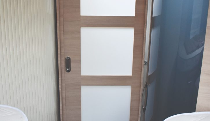 A panelled door partitions off the rear bedroom for privacy