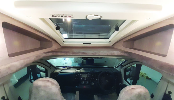 Large sunroof and storage in two spacious cubbyholes over the cab