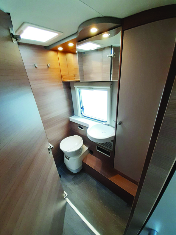 Washroom is wide and spacious, with a huge cupboard