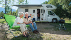 A couple sat in front of their motorhome
